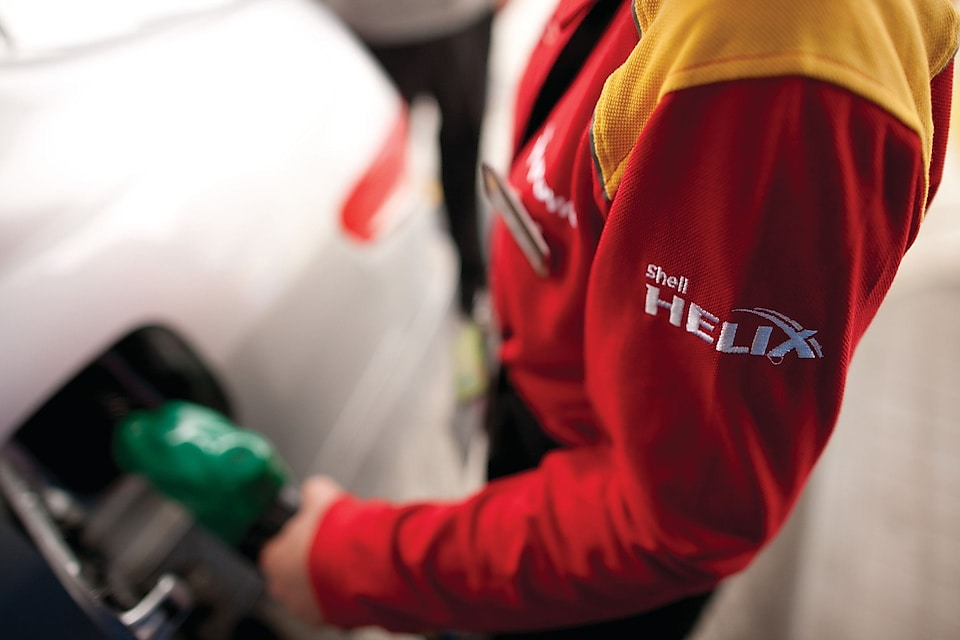 A man filling Shell fuel in the car