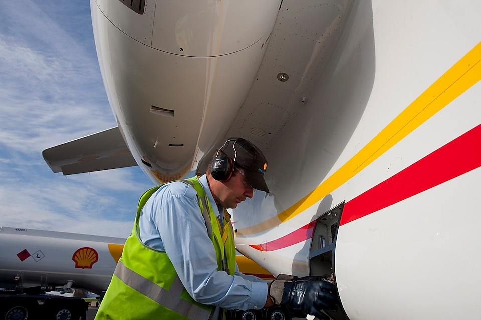 Man filling aviation fuel to plane